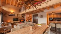 Open plan kitchen & dining area - luxury self catered chalet Haut Brion in Sainte Foy