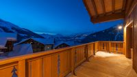 Luxury self-catered Estournel Chalet at twilight.