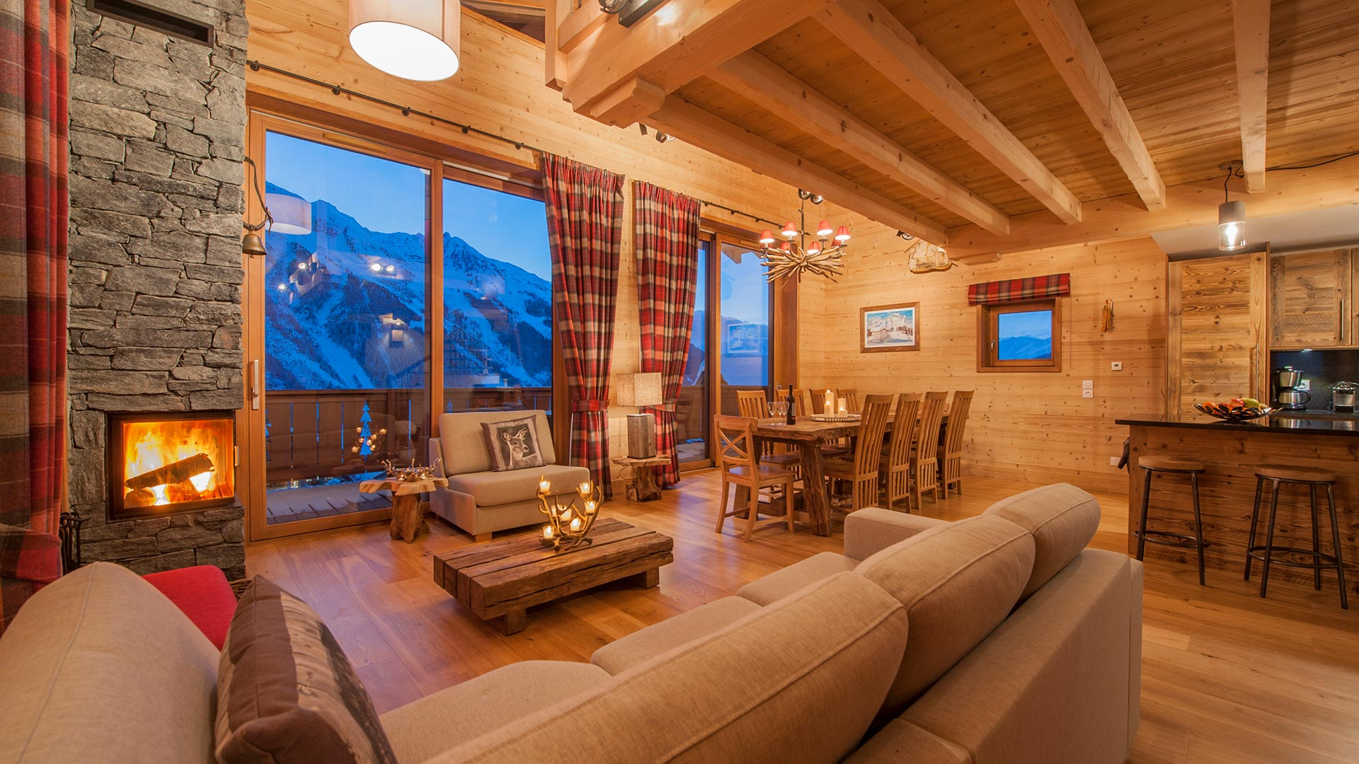 The living area of Rayas Chalet at twilight.